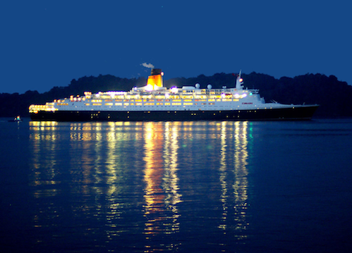 A Cruise ship journeys onwards in the silent night
